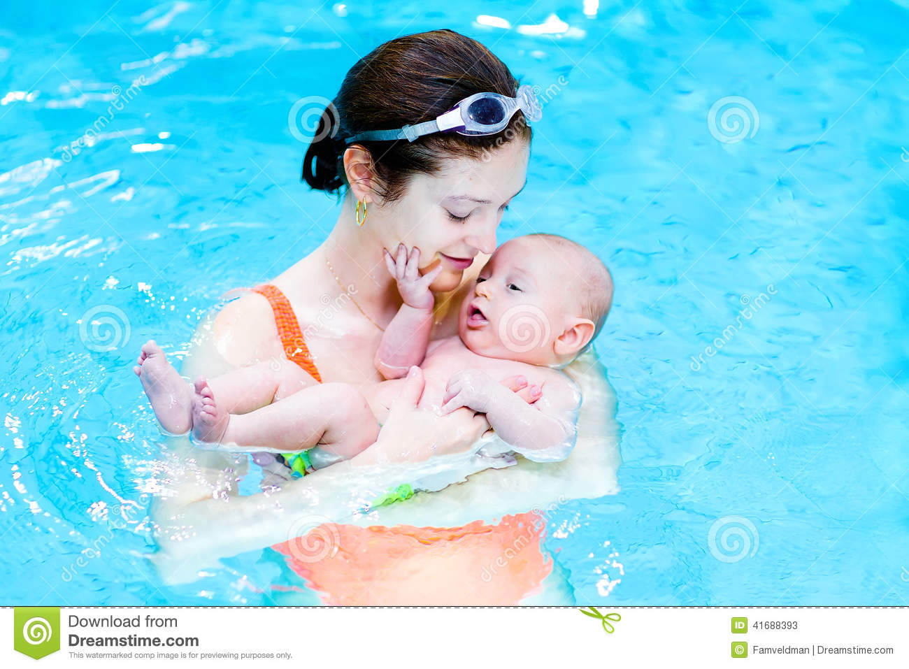 Cute baby boy in swimming pool with his mother