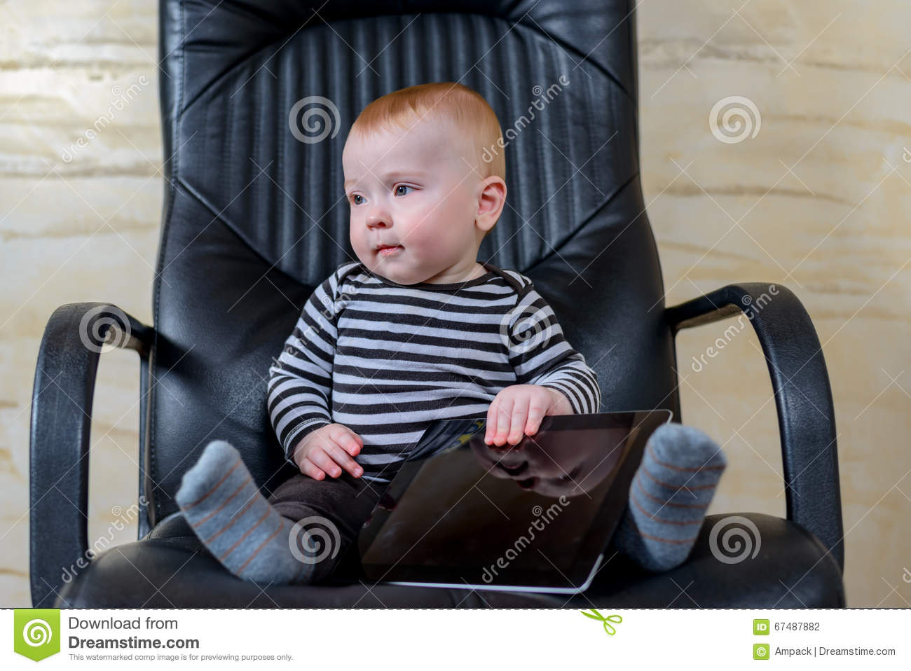 Black child sitting in chair - Royalty Free Stock Photo Download Cute Baby Boy With Tablet Sitting On Office Chair