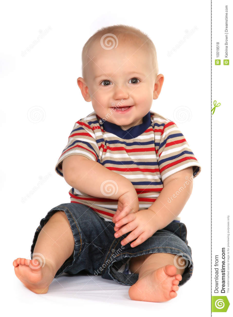Cute Baby Boy Toddler Sitting And Holding Hand Royalty Free Stock