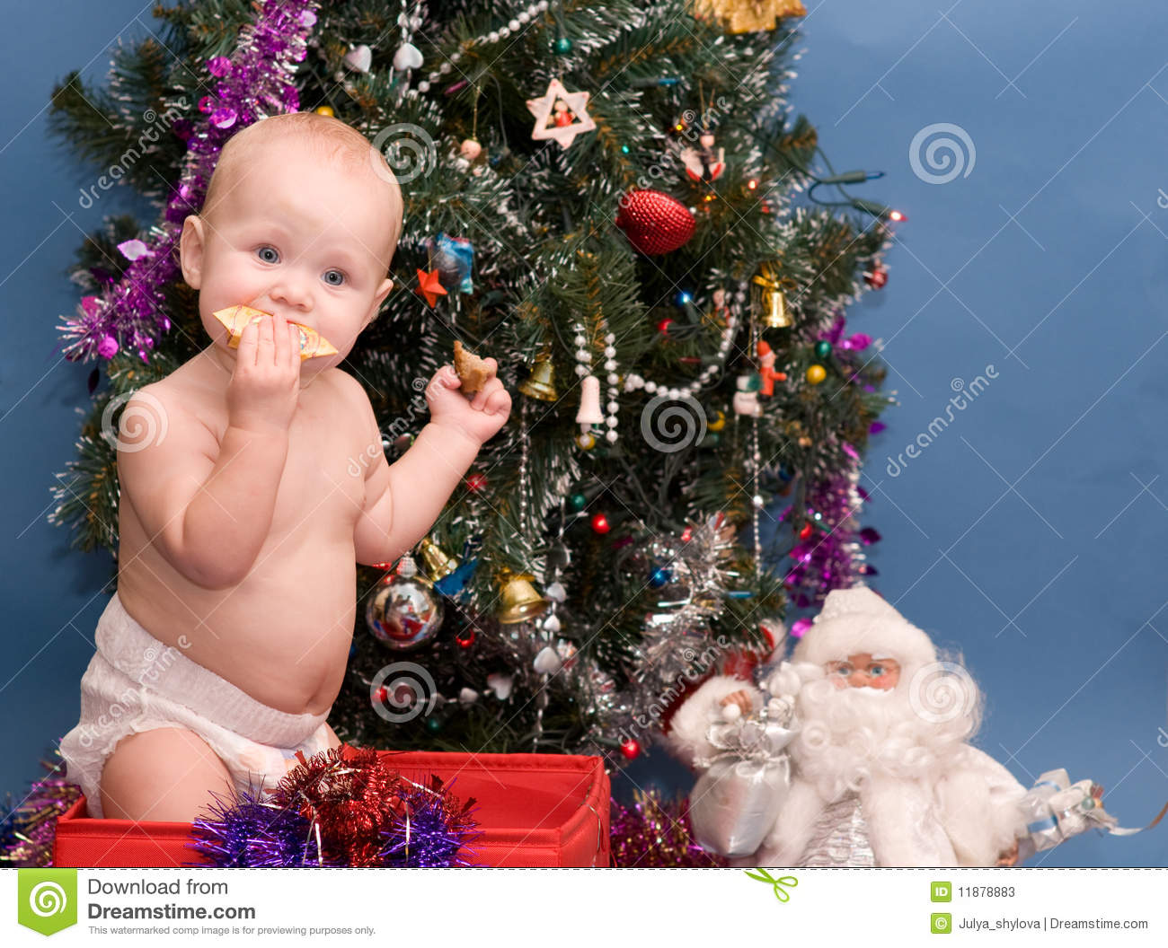 Cute Baby In Front Of Christmas Tree Stock Photos - Image: 11878883