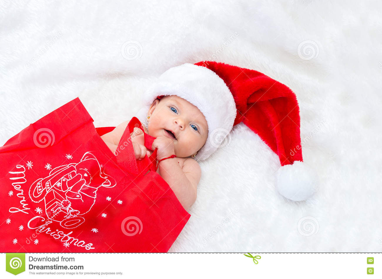 f297a08f9a Cute Baby Girl On The Bed Wearing A Santa Hat For Christmas. Stock ...