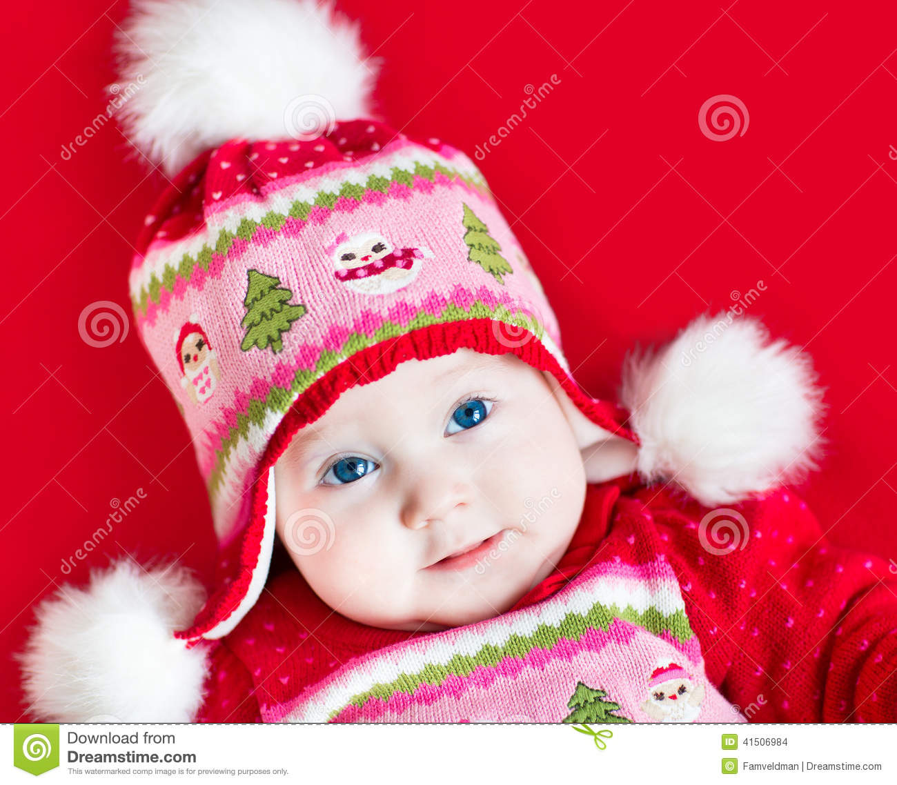 cute baby girl in christmas decorated knitted hat stock photo