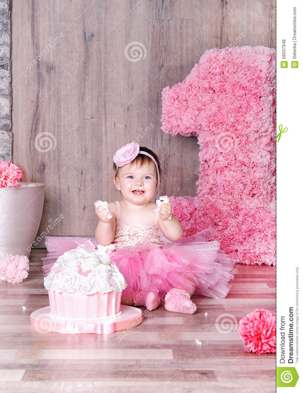 cute baby girl eating first birthday cake. stock photo - image of