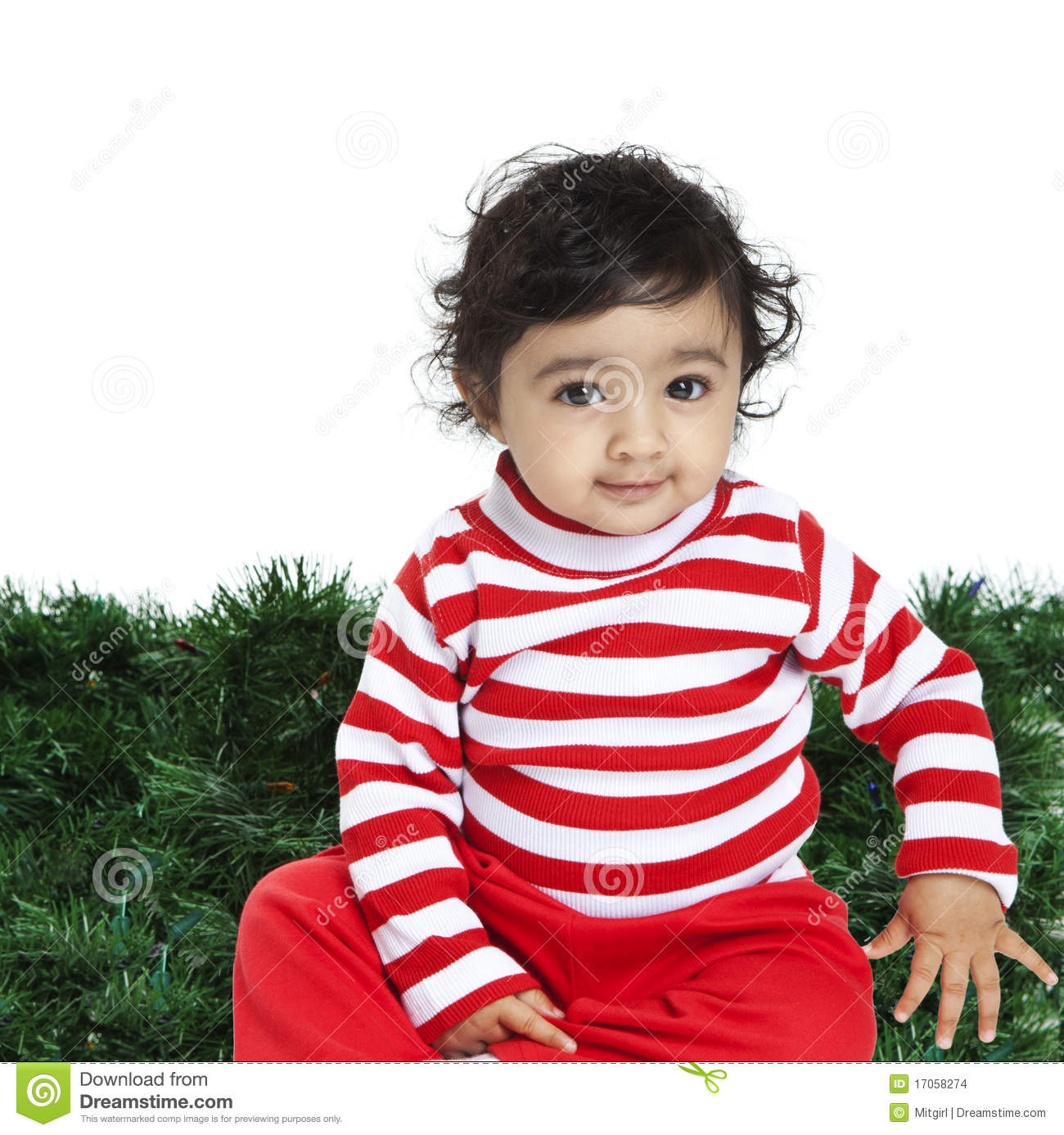 cute baby girl in front of an xmas background stock photo - image of