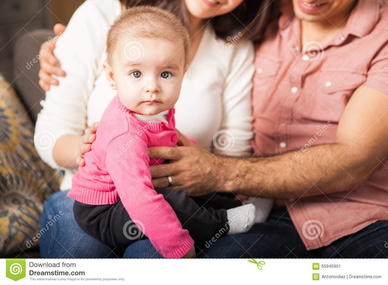 Cute Baby Girl With Her Parents Stock Photo