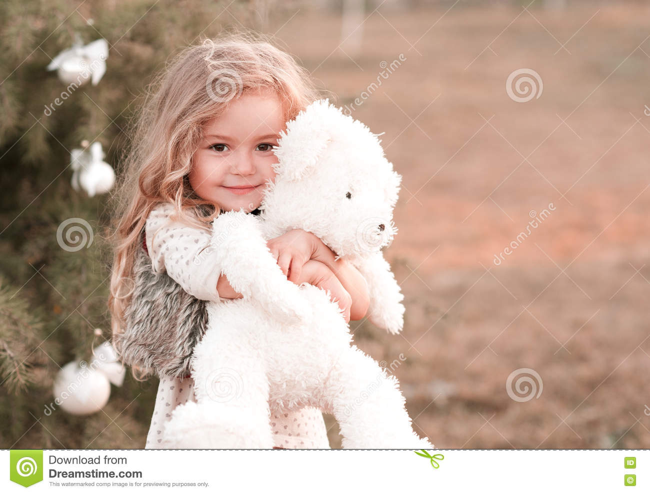 0f48ab479 Looking at camera. Cute baby girl holding bear toy. Smiling baby girl 4-5  year old holding