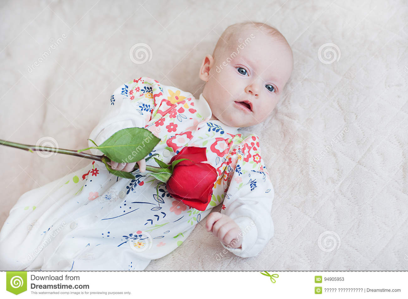 dab00579ae Royalty-Free Stock Photo. Cute baby girl holding a bouquet of flowers rose