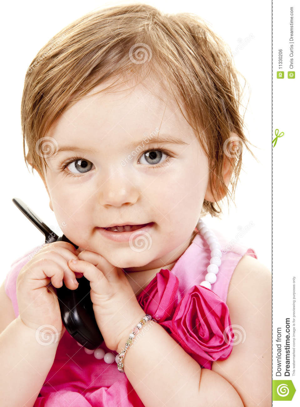 cute baby girl holding a cell phone stock photo - image of