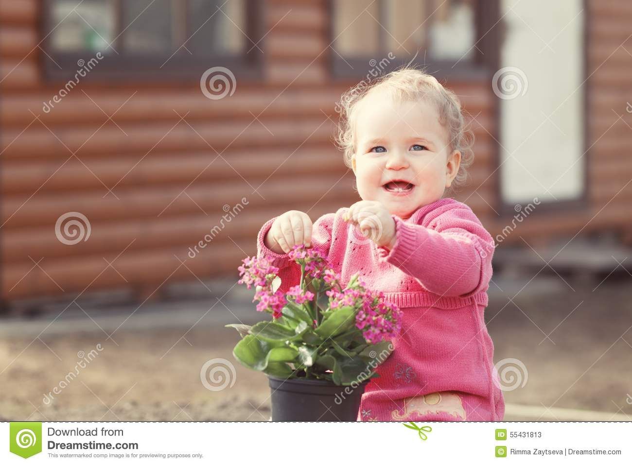 Cute Baby Girl In Pink Dress Puts Flowers Stock Image Image Of