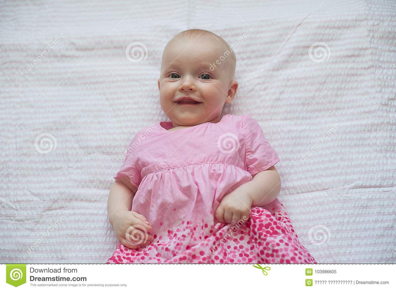 d44aa47d2 Cute Baby Girl In Pink Dress Lies On White Backgroun. Close-up ...