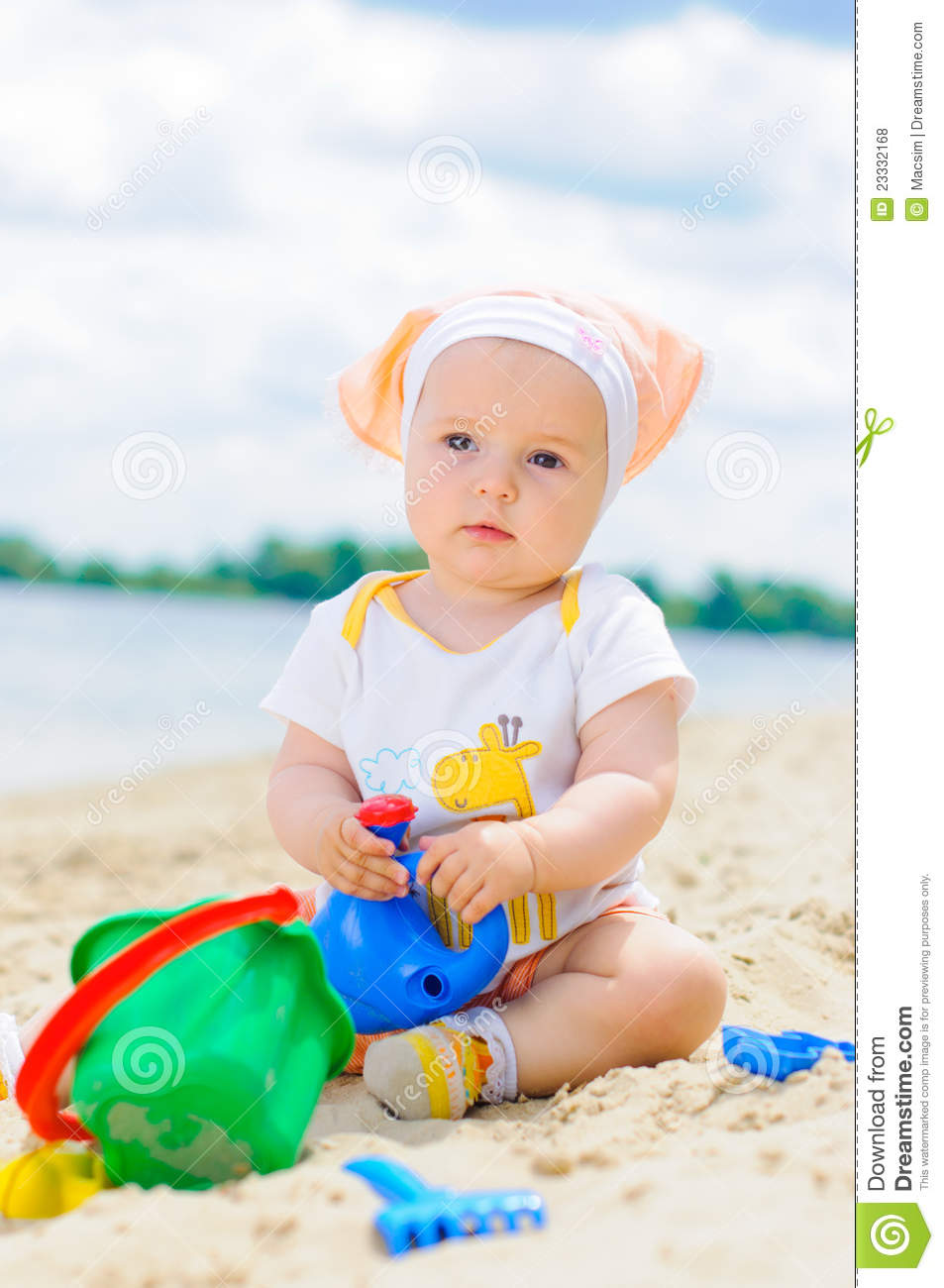 cute baby girl playing on the beach with sand. stock photo - image