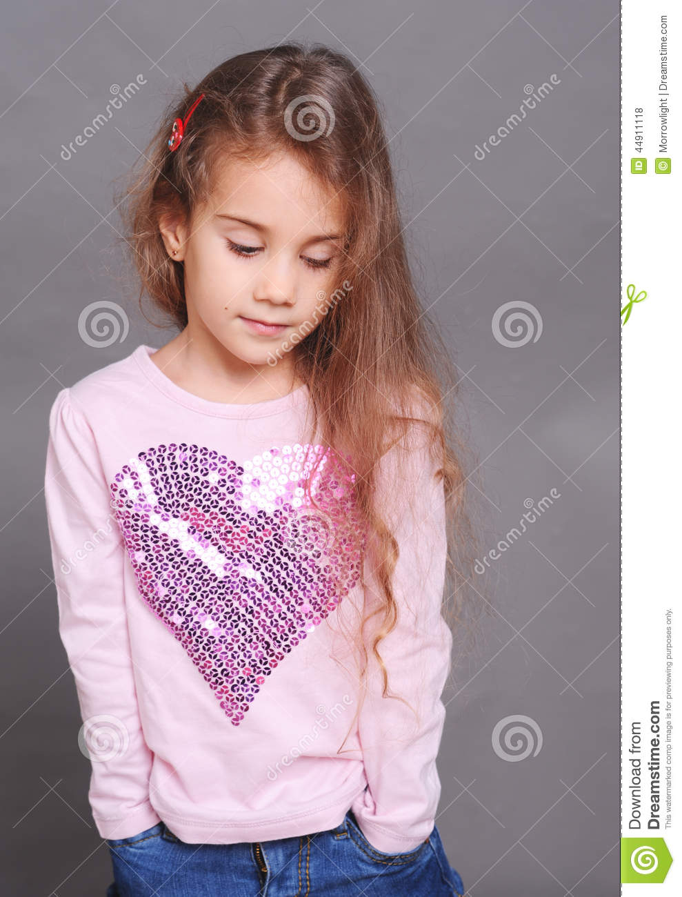 cute baby girl posing on gray in room stock photo - image of fashion