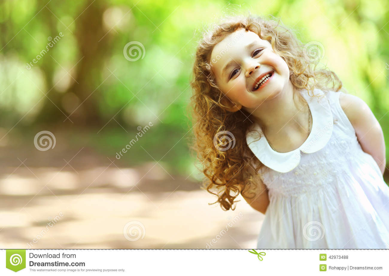 cute baby girl shone with happiness, curly hair stock photo - image