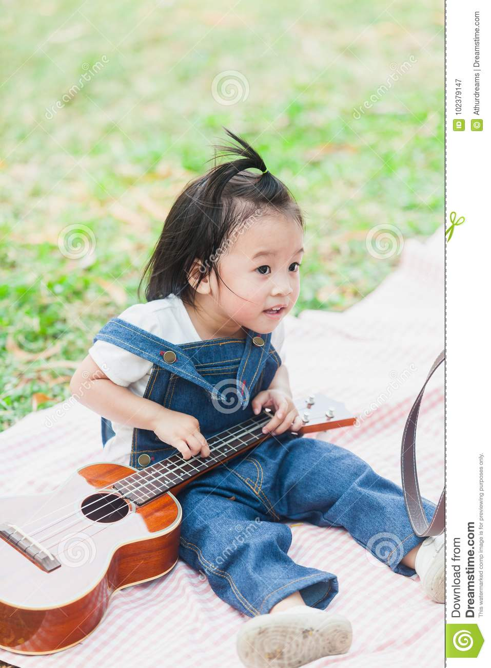 Cute Baby Girl 2 Year Old Play On Picnic Blanket Stock Image