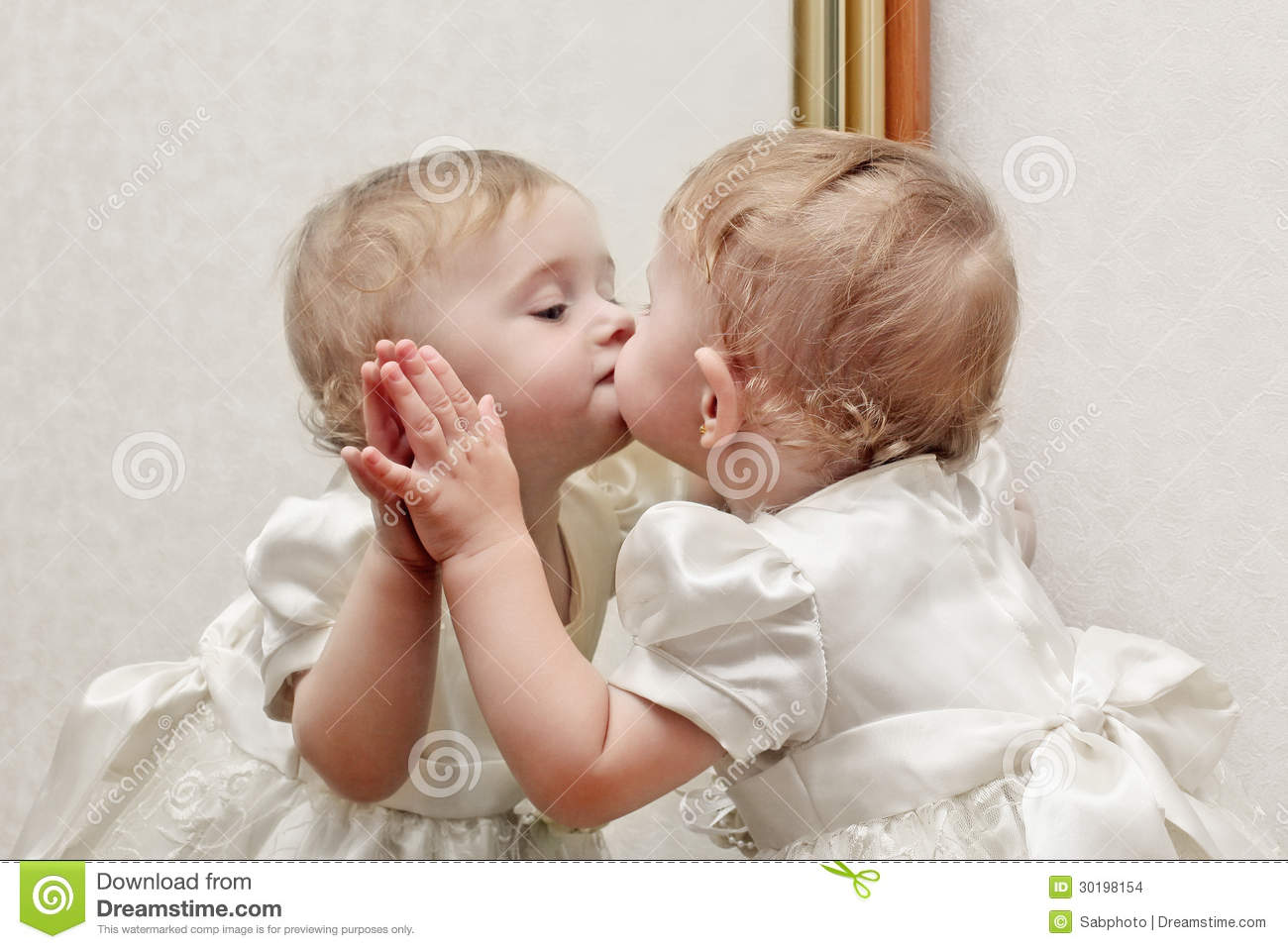 Baby Kissing A Mirror Stock Images - Image: 30198154