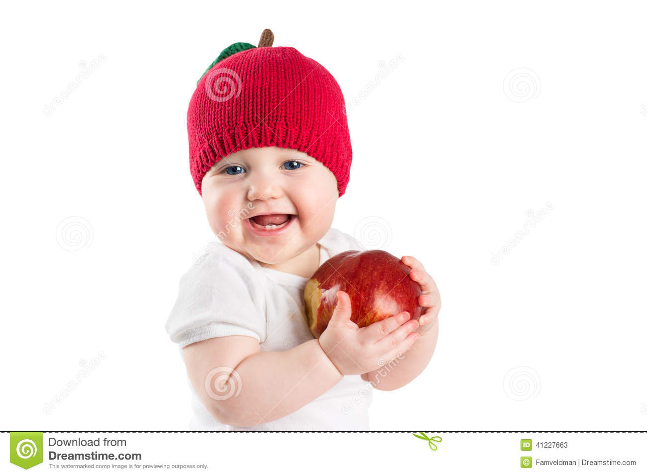 Cute baby in a knitted apple hat biting in a red ripe apple, isolated on white
