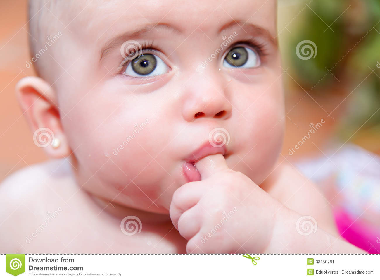 Cute Baby Licking Her Finger Stock Image - Image: 33150781