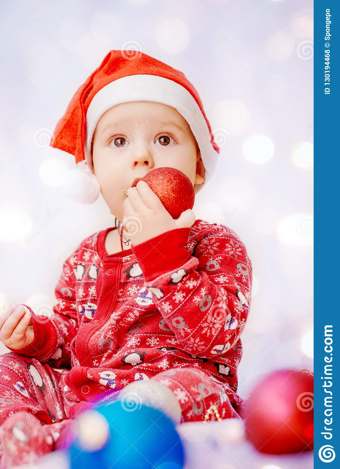 8a968cbf9 Cute Baby In Pajamas And Santa Claus Hat On Christmas Background ...
