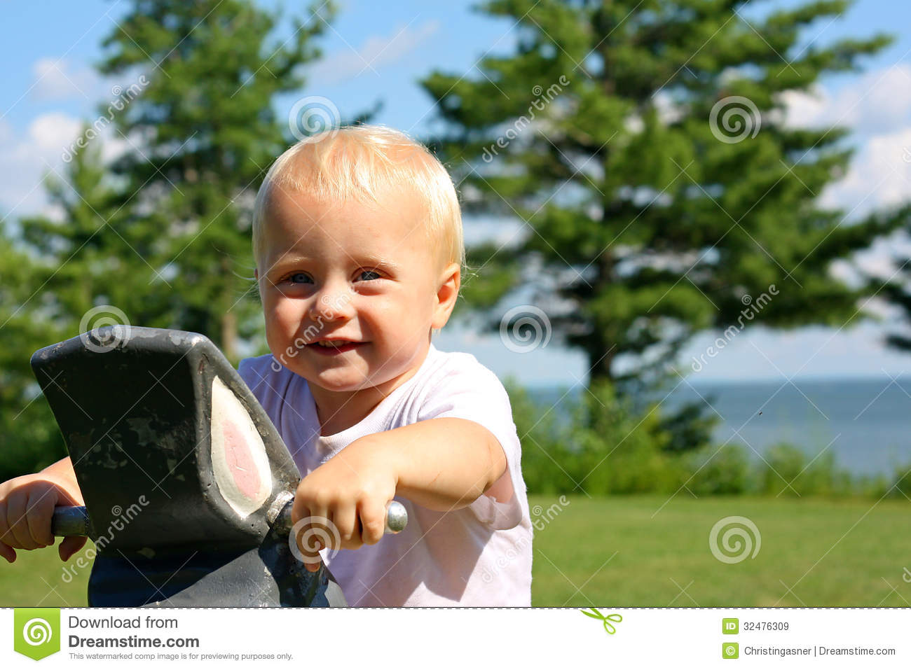 Lake Toys For Boys : Cute baby at park by lake royalty free stock images
