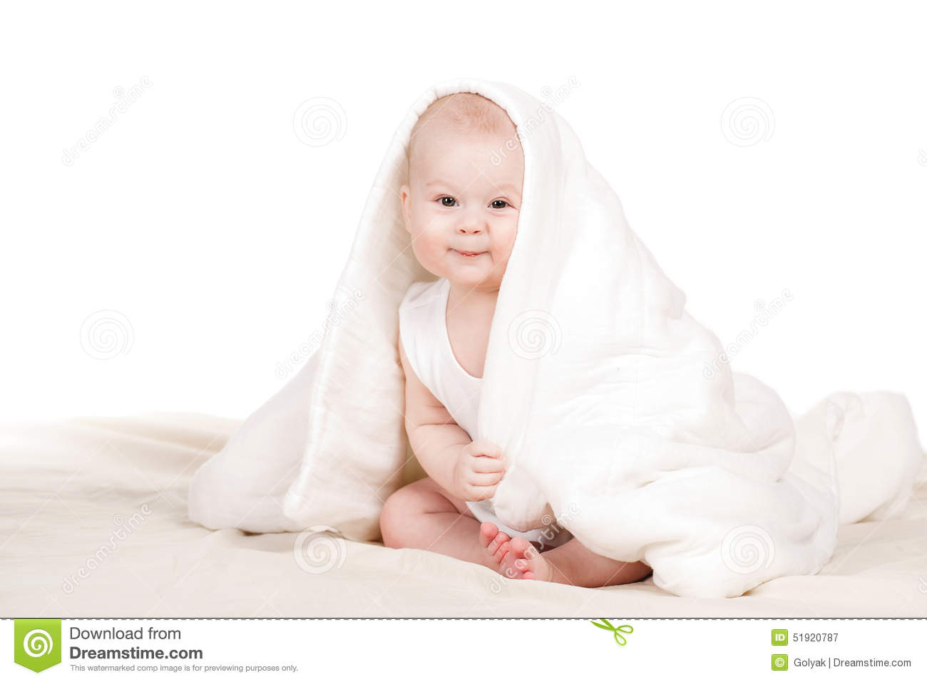 cute baby peeking out from under the blanket. stock image - image of