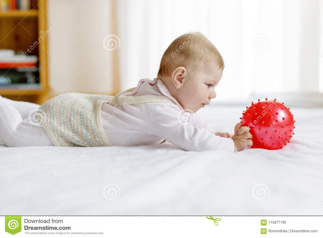 1e8beba4f3c Cute Baby Playing With Red Gum Ball