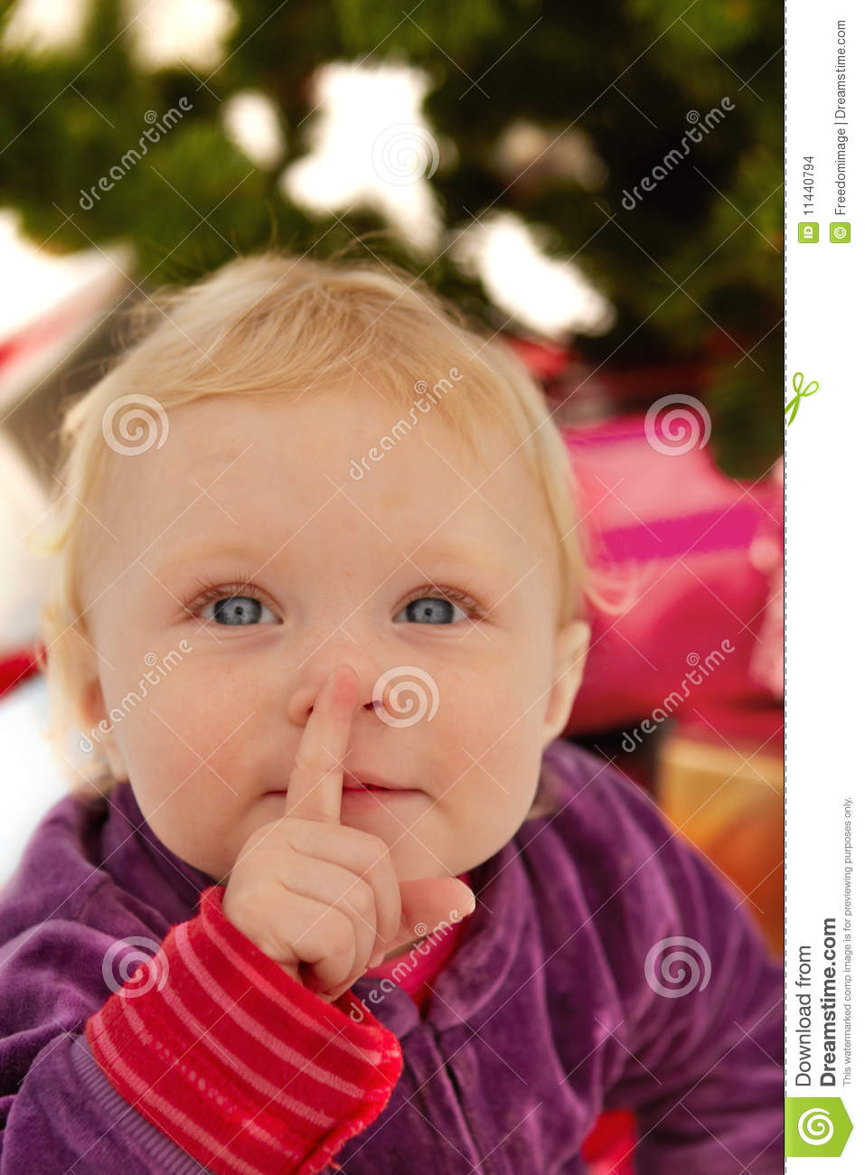 Cute Baby Saying Shhh - At Christmas Stock Images - Image: 11440794