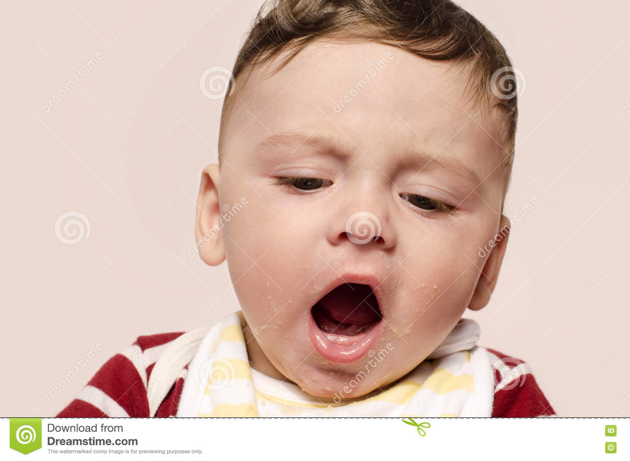 Cute Baby Screaming Refusing To Eat Baby Food. Stock Photo ...