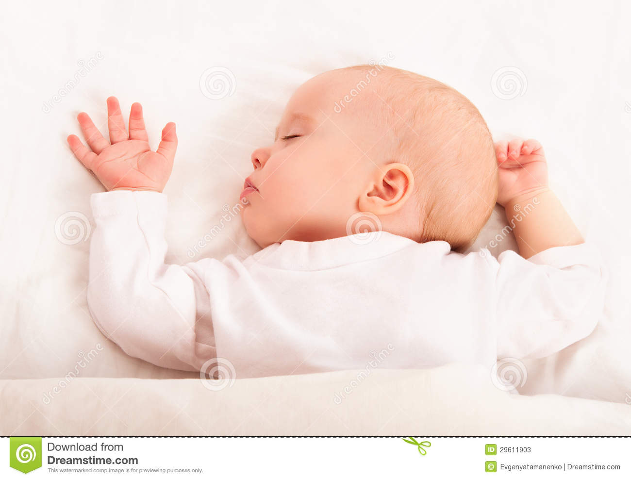 Cute Baby Sleeping In The Bed Stock Image