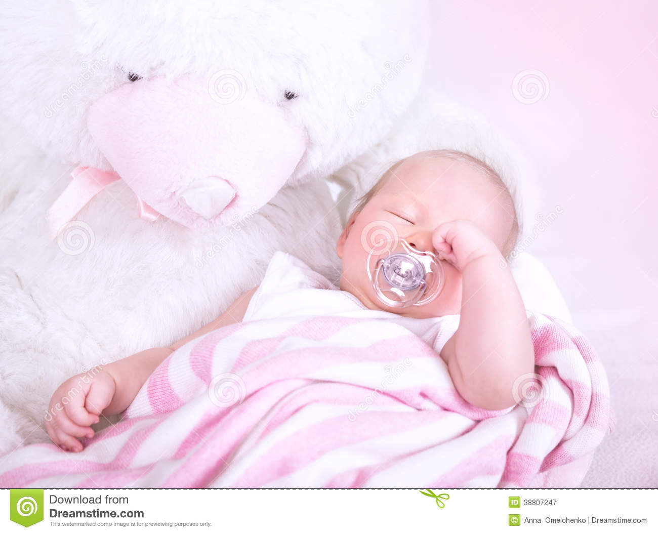 Cute newborn baby sleeping with pacifier in mouth, lying down on big ...