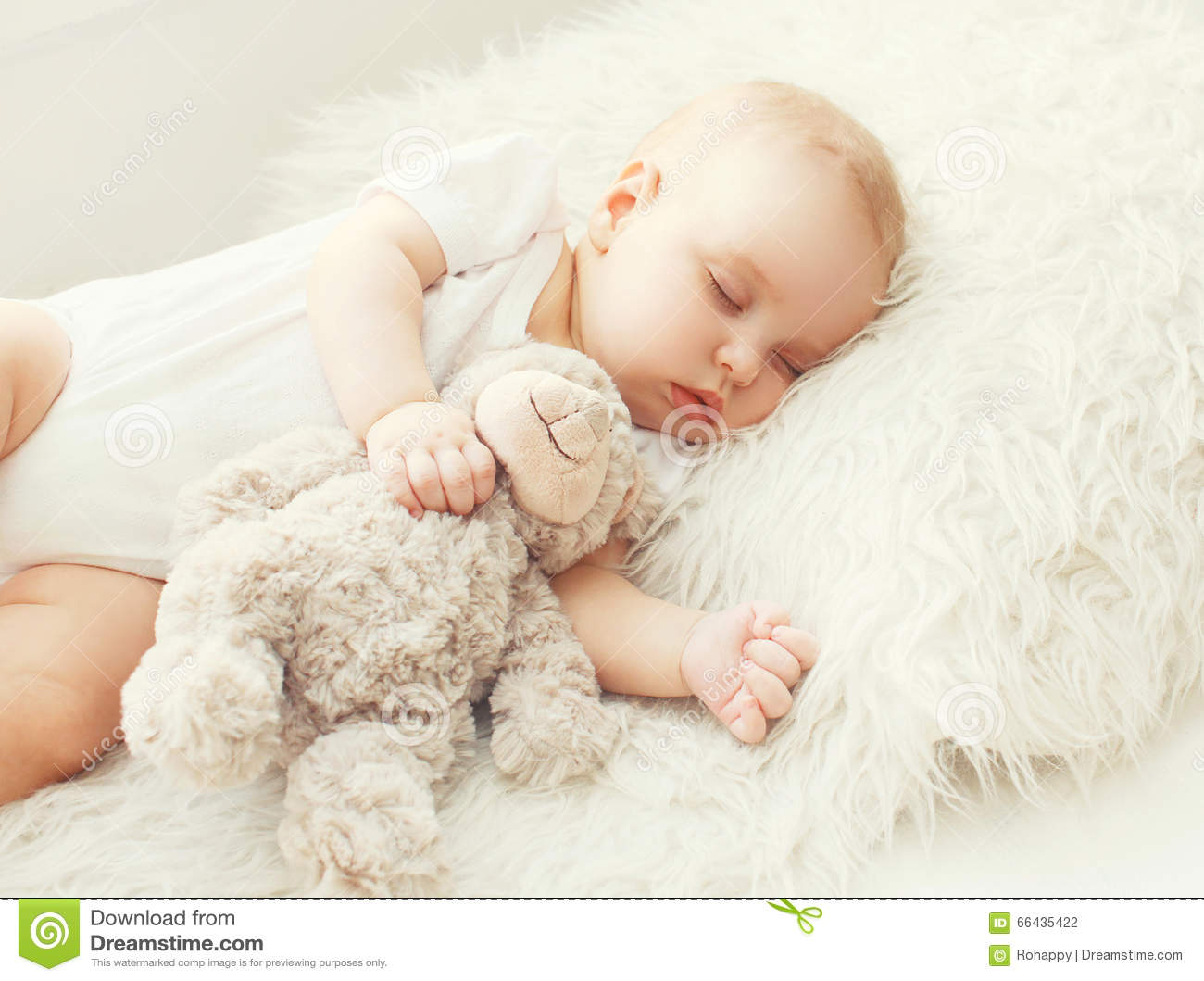cute baby sleeping on soft bed home stock photo - image of months