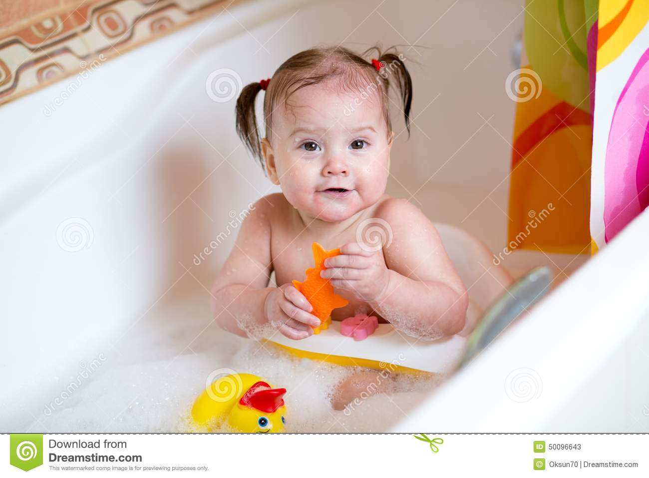 Cute baby taking a bath stock image. Image of little - 50096643