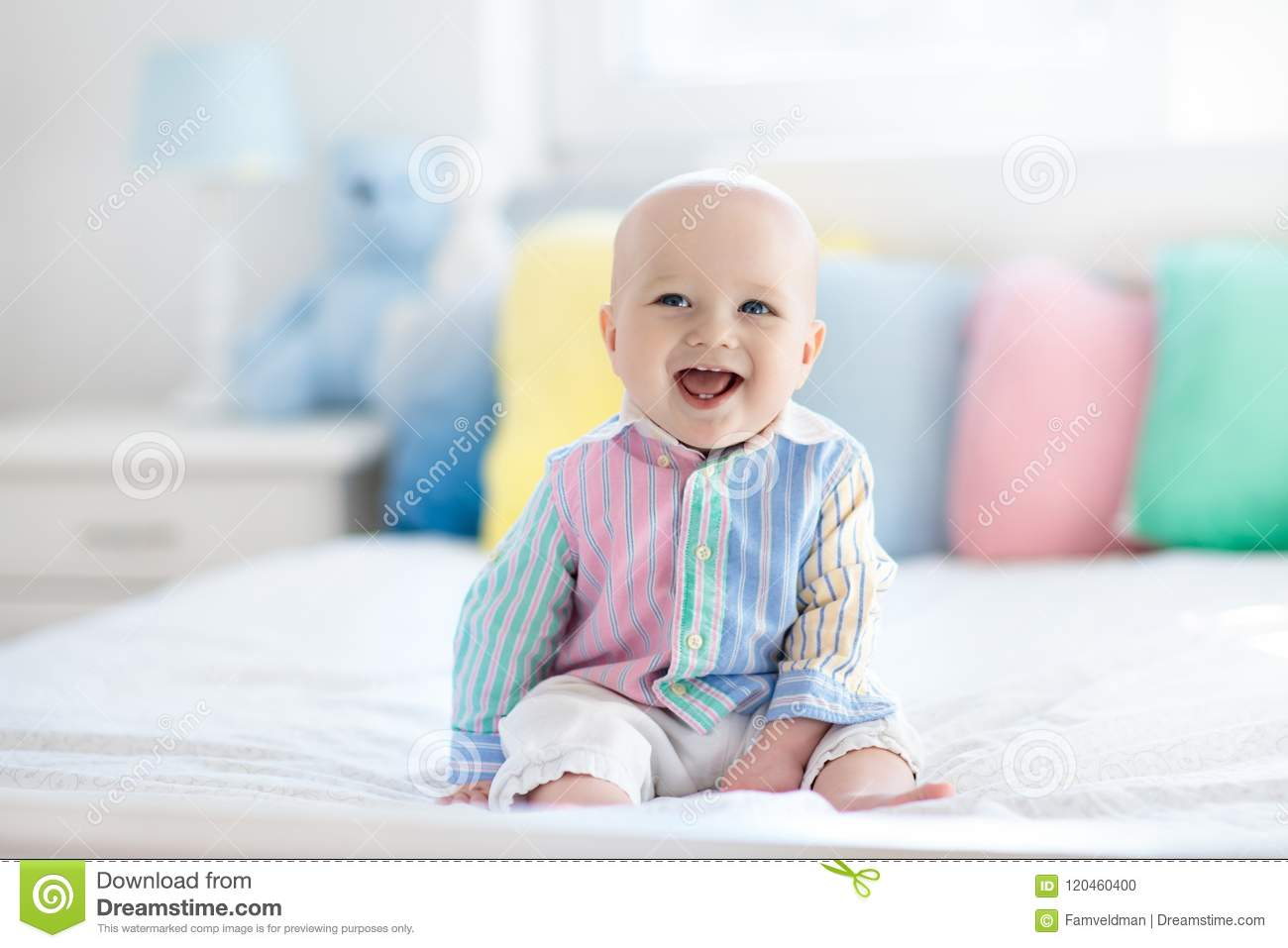 Download Cute baby on white bed stock photo. Image of home, indoors - 120460400