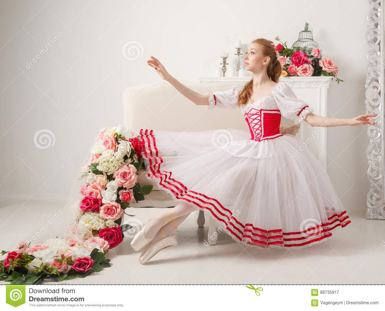9bb21915a802 Cute ballerina in stage costume next to bouquets of spring flowers. Retro  dress.