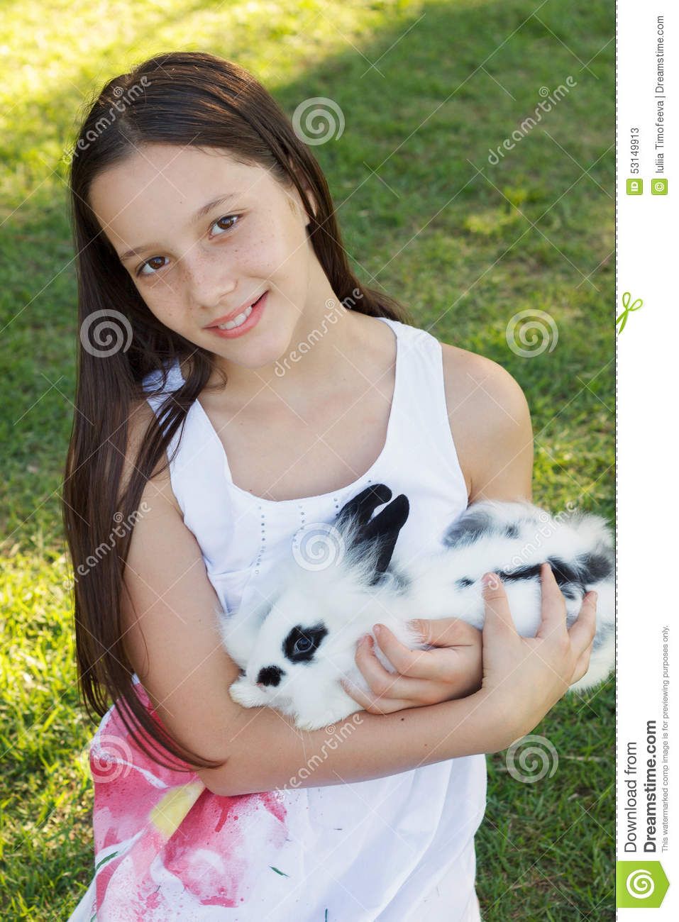 Cute beautiful smiling teen girl holding at white black rabbit for Cute teenager girls