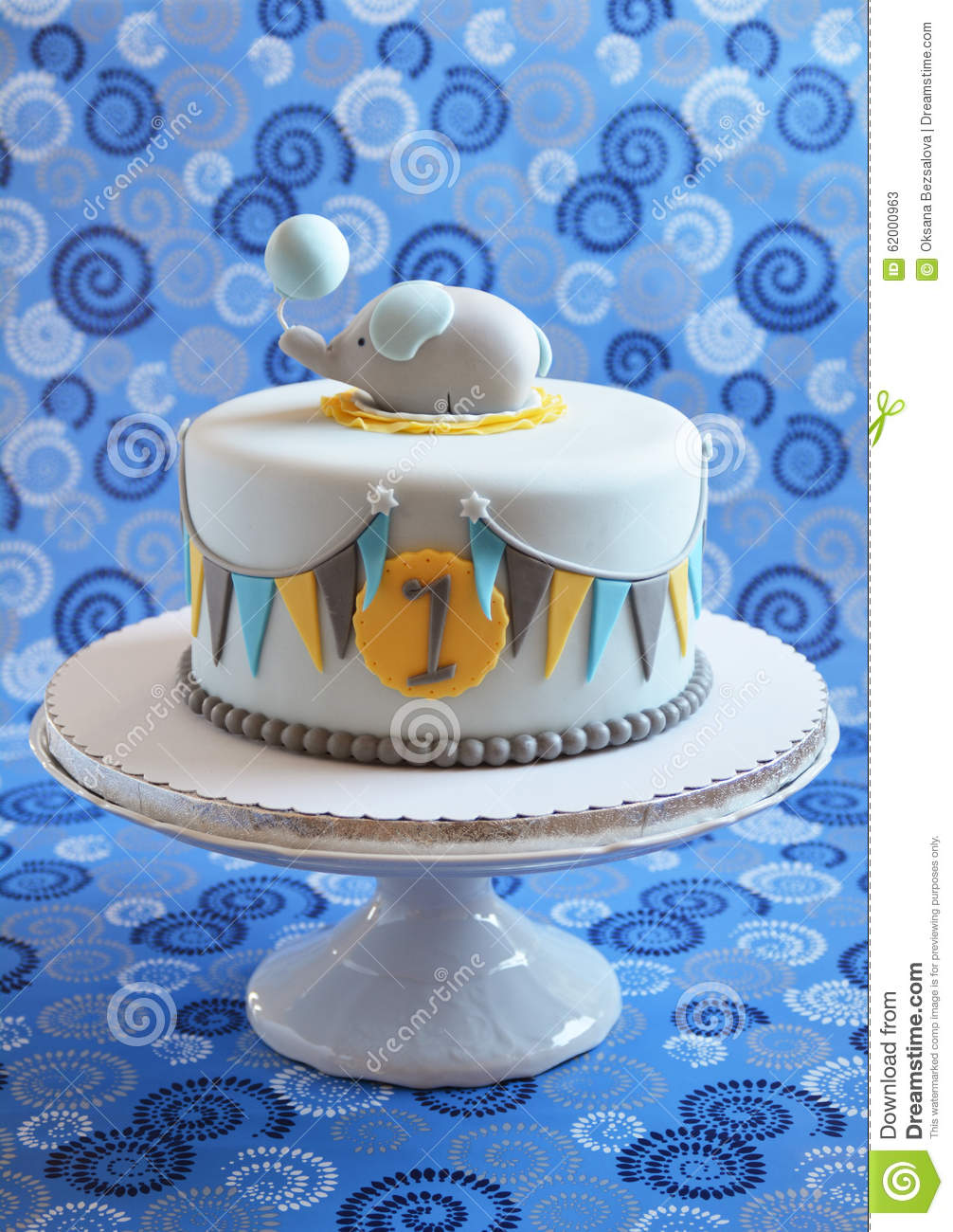 Cute Birthday Cake Decorated With Fondant Flags And Small Elephant