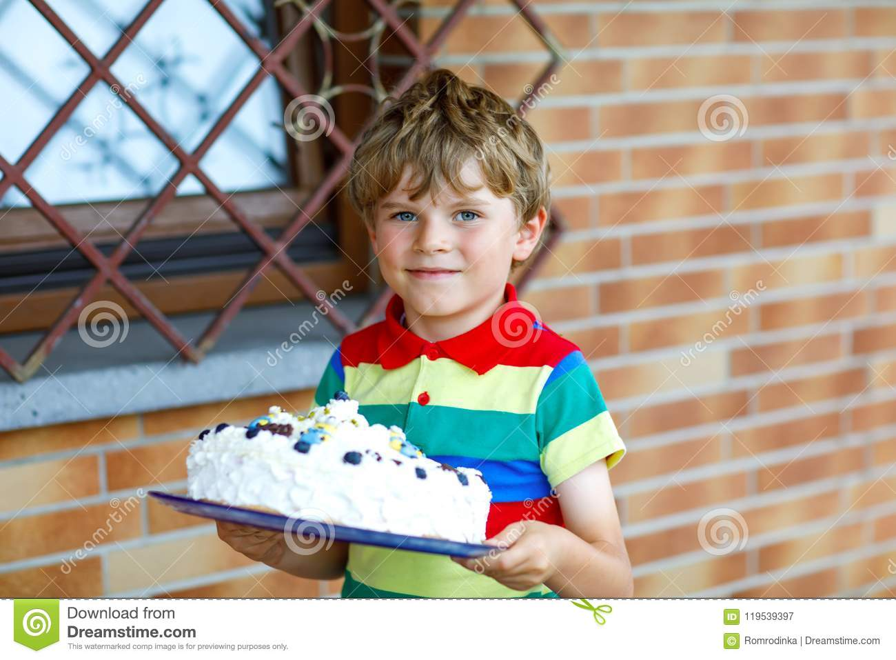Cute Blond Kid Boy Holding Big Birthday Cake Happy Smiling Child Celebrating