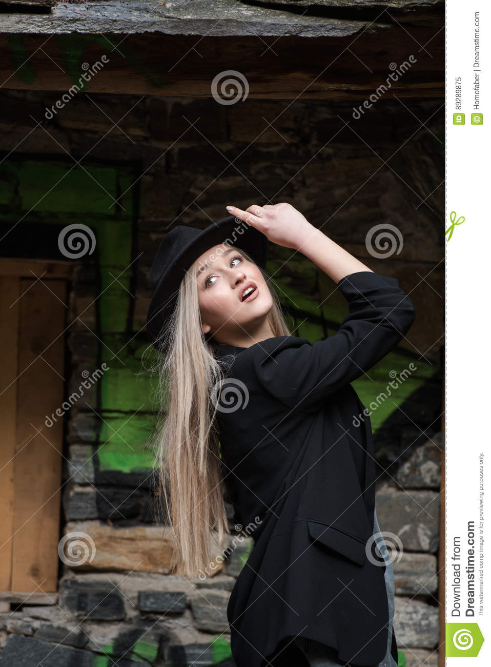 Cute blond teen wear black jacket and hat
