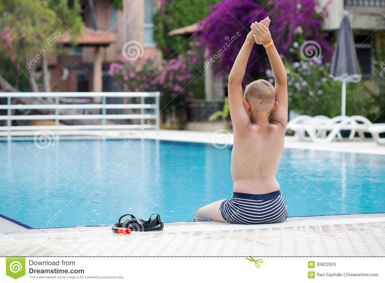 A cute blonde boy learning to dive
