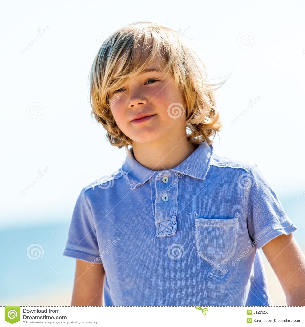 cute boy with blue polo shirt outdoors stock photo image of
