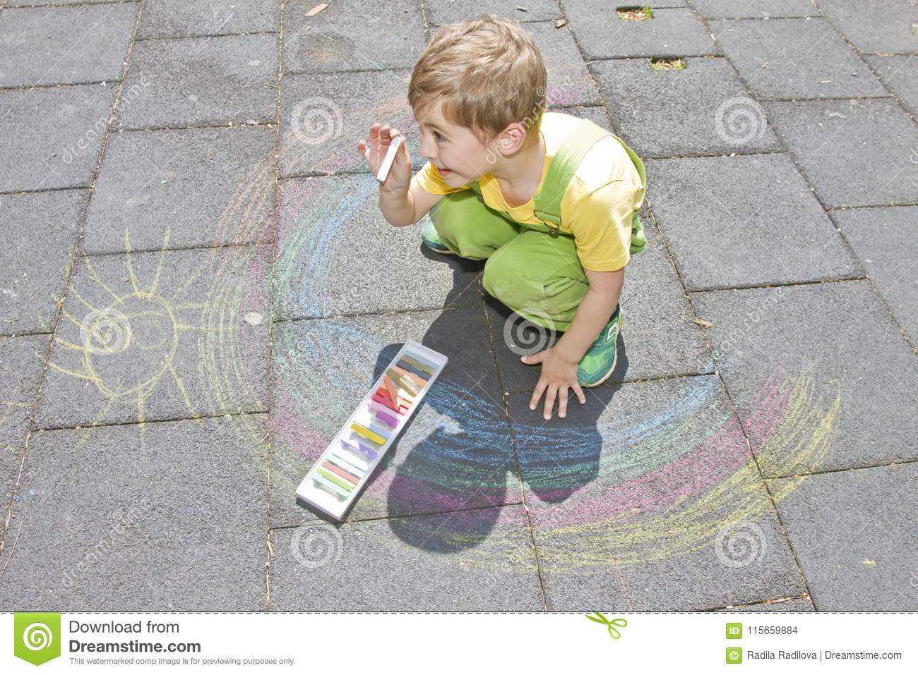 Cute Boy Draws With Colorful Chalks On Asphalt Summer Activity And