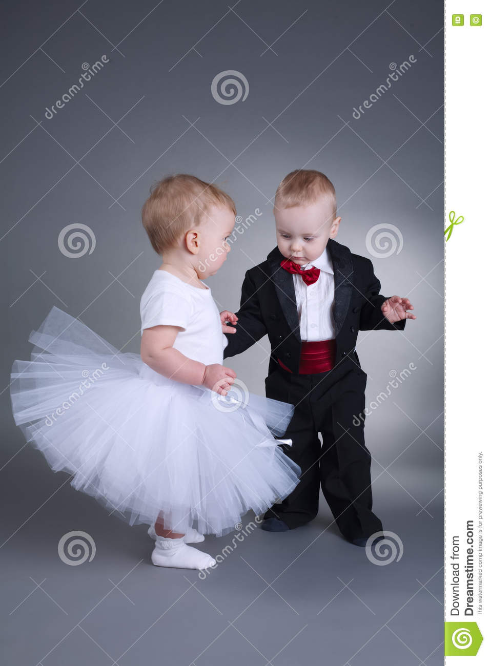Cute Boy And Girl In Wedding Dress Stock Photo - Image of playing ...