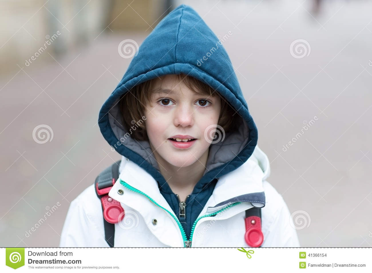 Cute boy on his way to school on a cold day