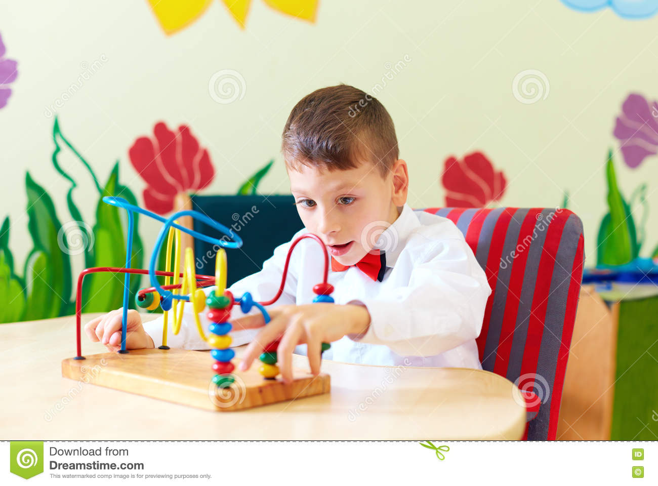 Cute Boy Kid In Wheelchair Solving Logical Puzzle In