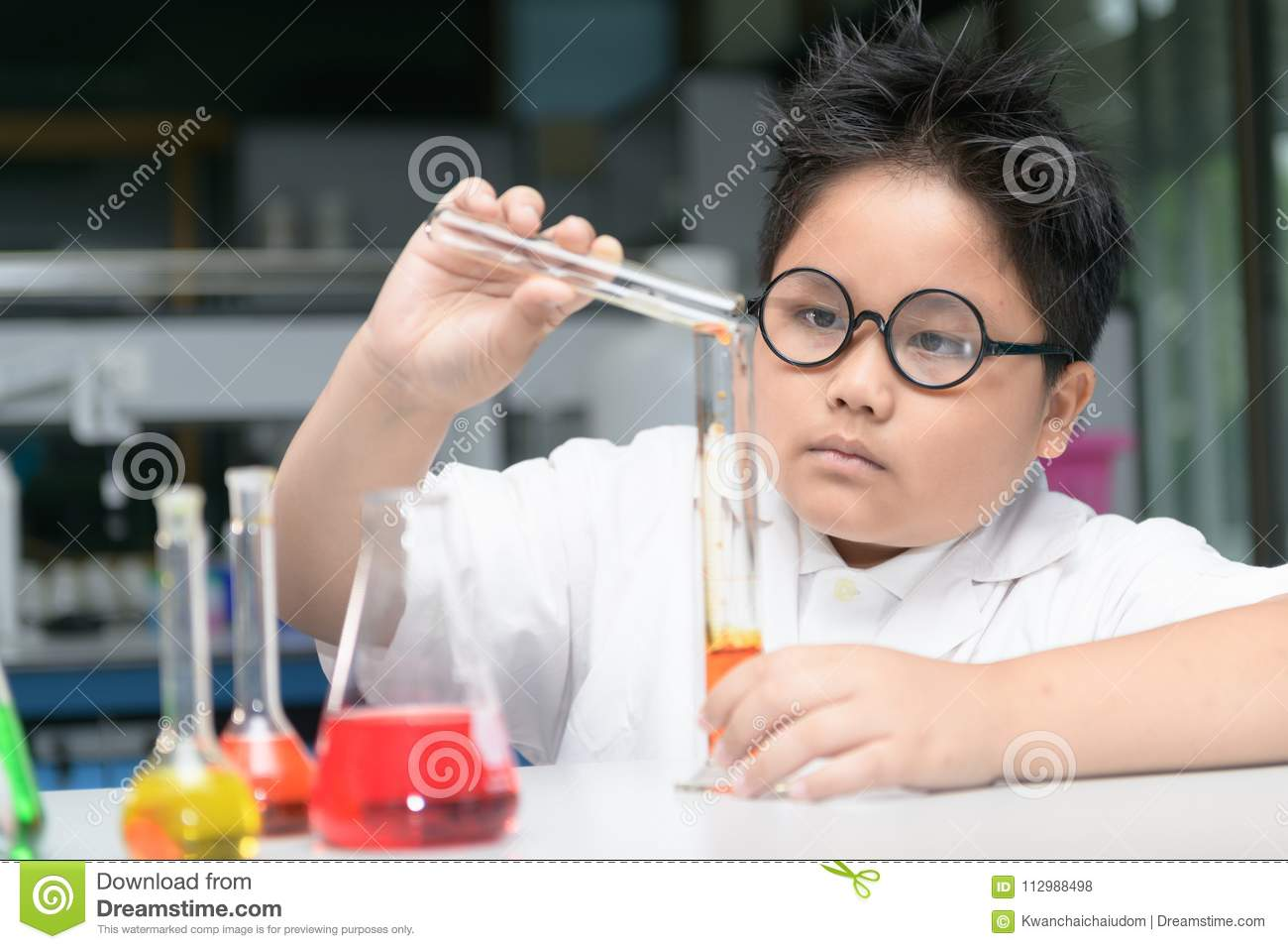 Cute boy making experiment with test tube