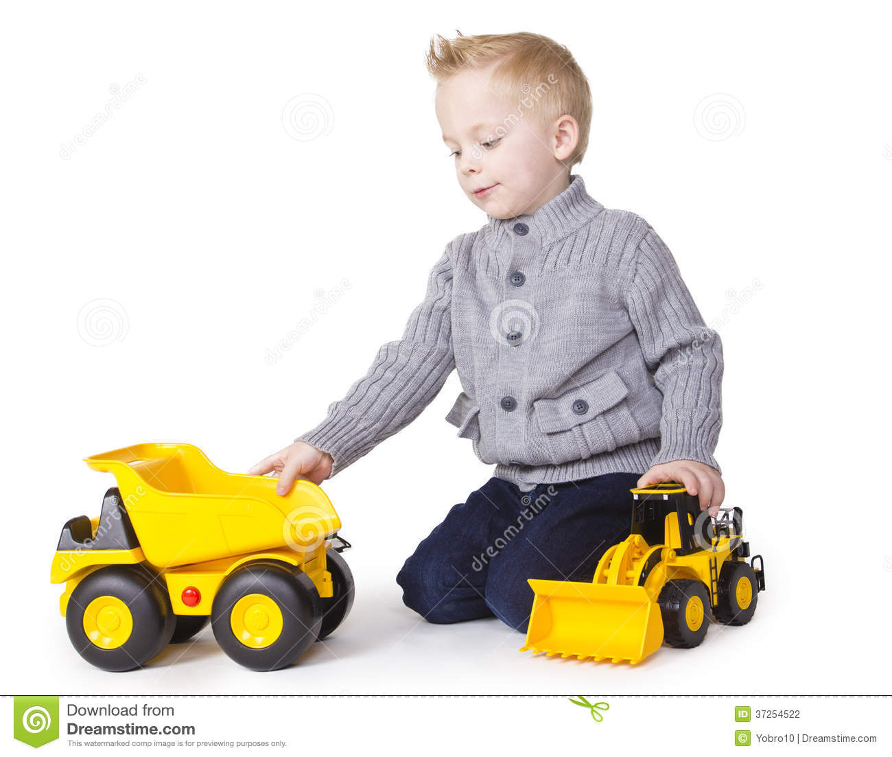 Toy Trucks For Boys : Cute boy playing with toy trucks stock photo image