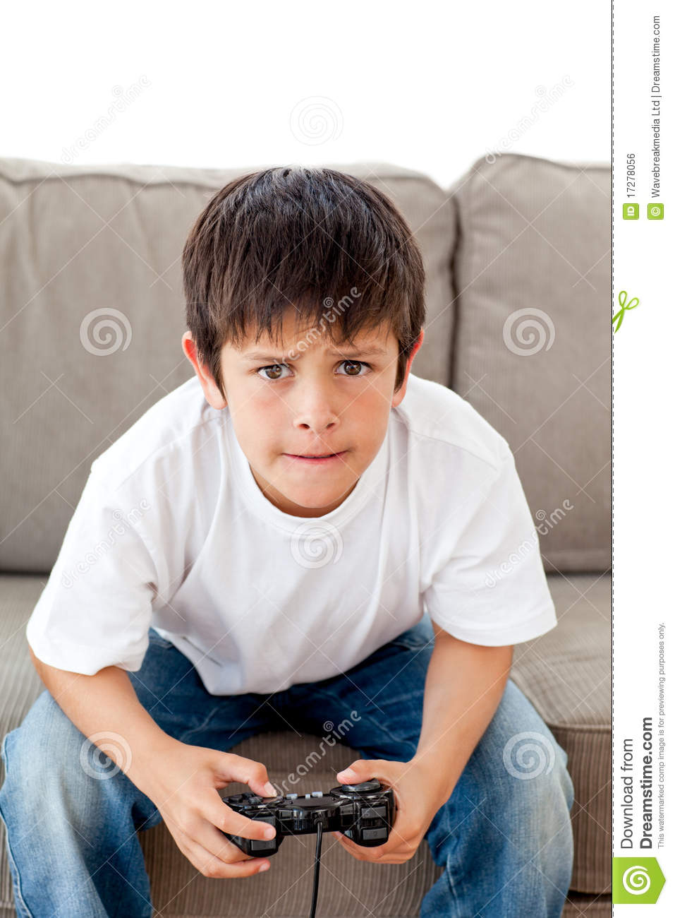 Cute Boy Playing Video Games Sitting On The Sofa Royalty  : cute boy playing video games sitting sofa 17278056 from dreamstime.com size 957 x 1300 jpeg 120kB