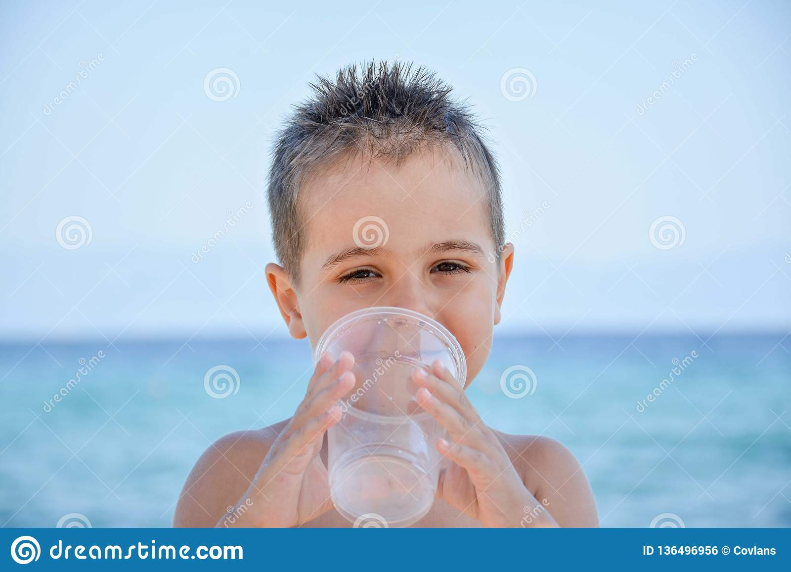 A cute boy posing on the beach