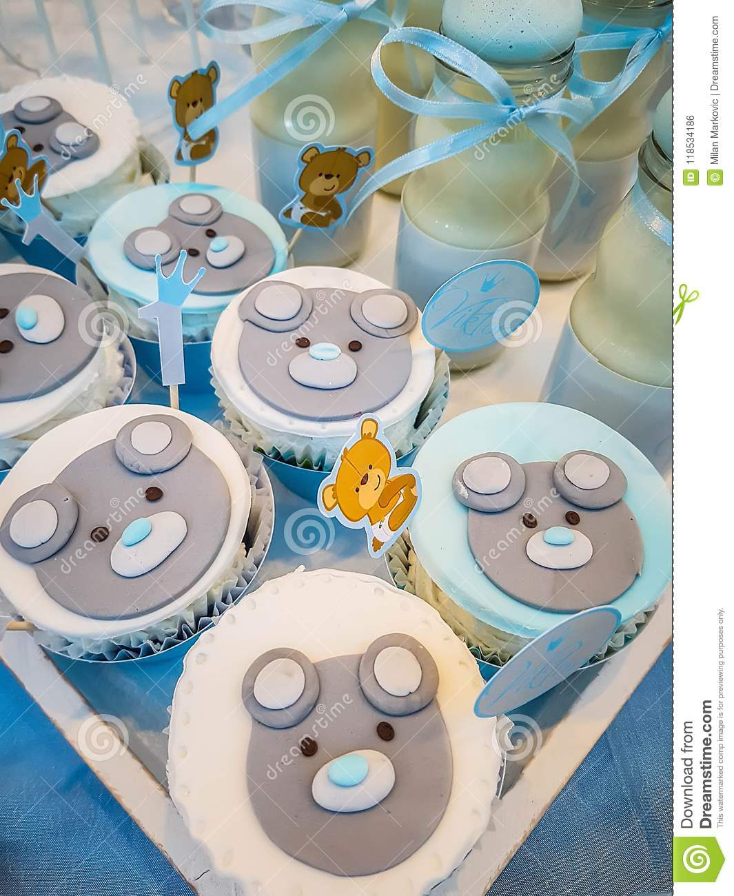 The boy`s birthday, blue, Birthday Boy Blue Party with Candy Presents and Cupcakes