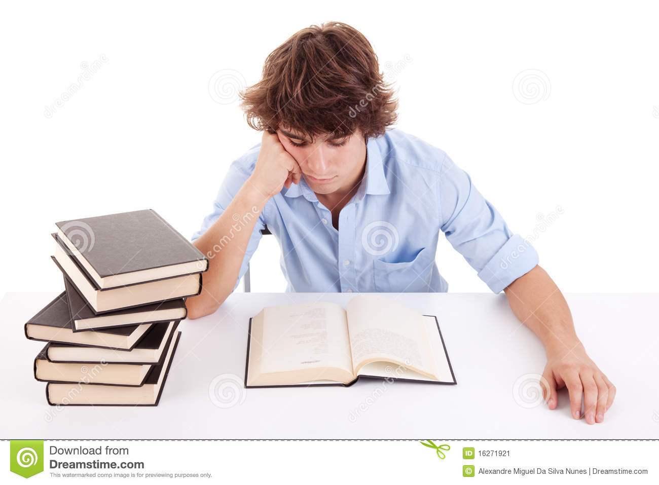 Studying And Reading A Book On His Desk Stock Image - Image: 16271921