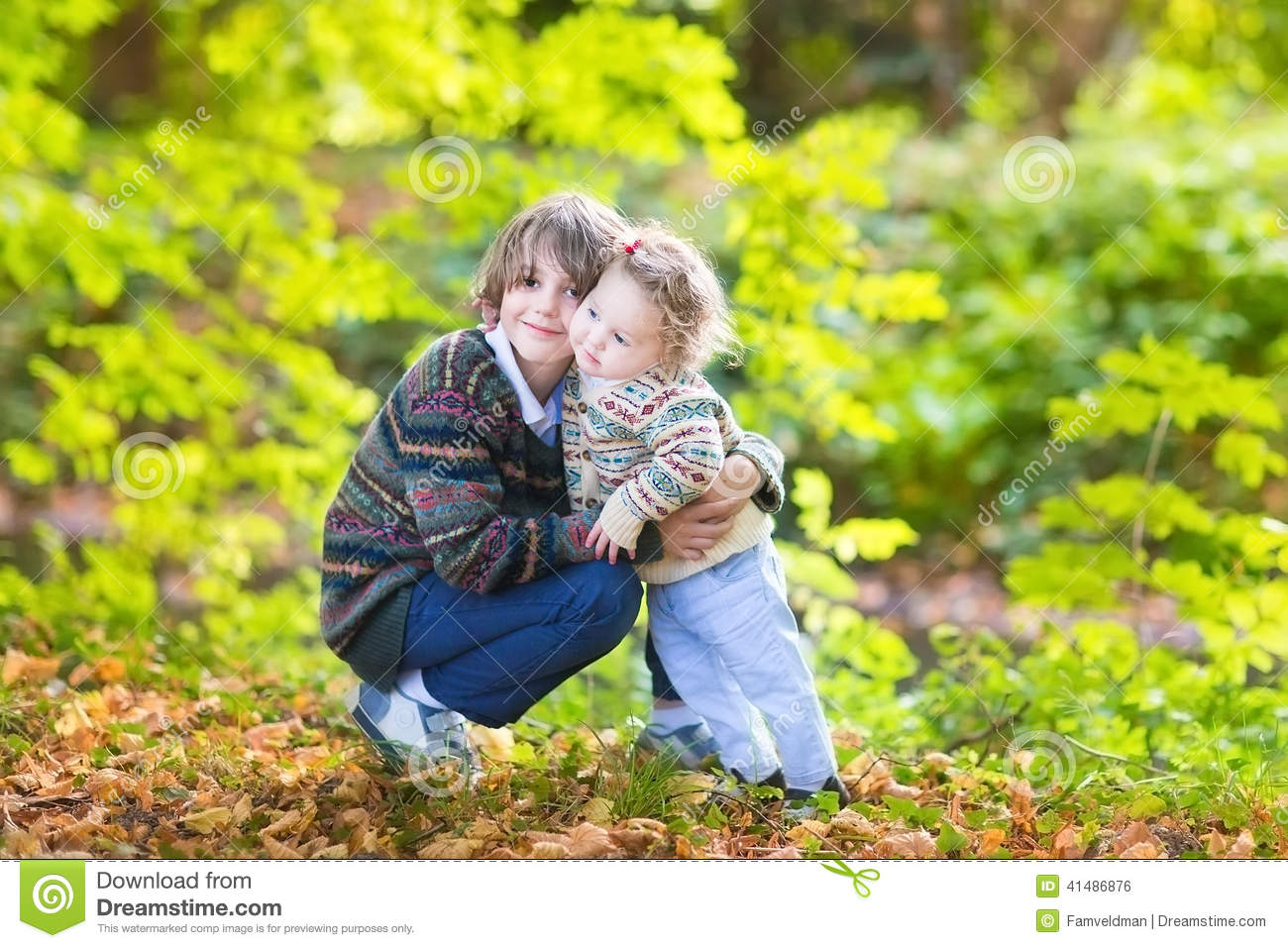 Cute Brother And His Baby Sister Hugging In Park Stock Photo Image